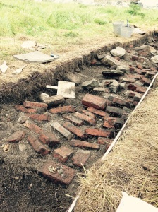 We think this is a collapsed double fireplace.  The brick and stonework is puzzling.
